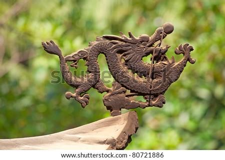 Bronze dragon on the incense pot in Po Lin monastery on Lantau Island (Hong Kong) - stock photo