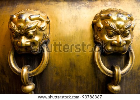 Bronze figure of lion head and handle, it's typical and traditional statues in Forbidden City, Beijing China.