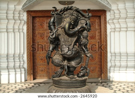 bronze ganesh statue in temple delhi india - stock photo