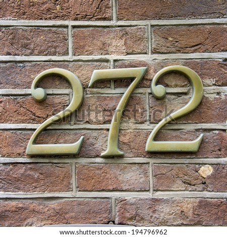 bronze house number two hundred and seventy two. - stock photo
