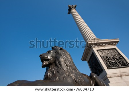 Bronze lion and Nelson's memorial on Trafalgar square, London. - stock photo