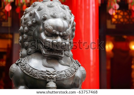 Bronze lion in chinese temple - stock photo