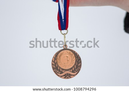 Bronze medal in white background for winners in winter games