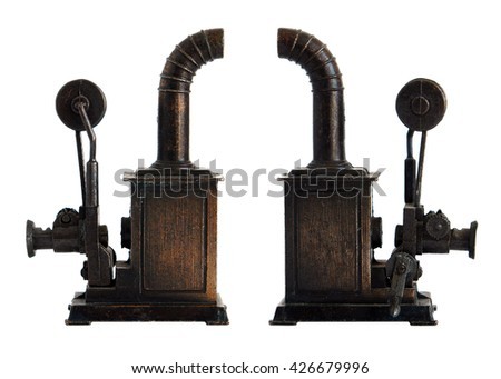 Bronze miniature of old movie projector isolated on white background                            - stock photo