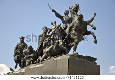 Bronze monument of V.I. Chapaev and cavalry against the blue sky. Russia. Samara - stock photo
