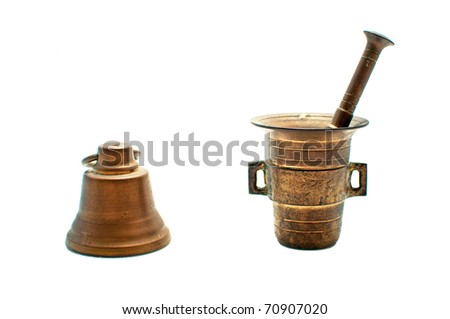 Bronze mortar with pestle and old bell isolated on white background - stock photo