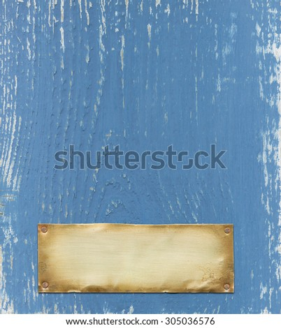 Bronze nameplate on blue background