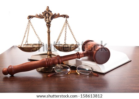 Bronze scales, gavel, glasses and a book on the table - stock photo