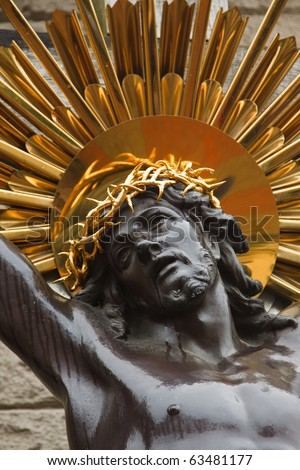 Bronze sculpture of the crucifixion of Jesus Christ - stock photo