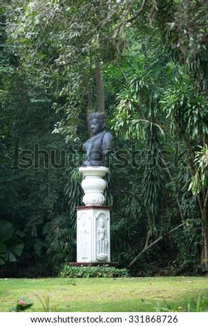 Bronze statue Bodhisattva in the garden - stock photo