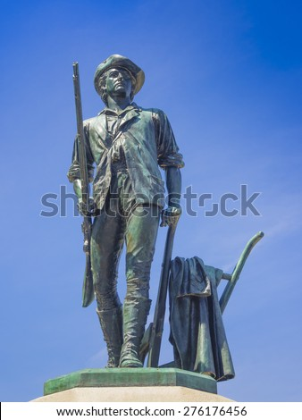 Bronze statue of a Minuteman in Concord, MA. It was sculpted by Daniel Chester French from melted down Civil War cannons.  - stock photo