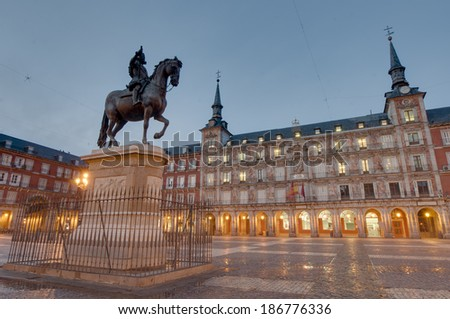 Bronze statue of King Philip III at the center of the square, created in 1616 by Jean Boulogne and Pietro Tacca on the Plaza Mayor in Madrid, Spain. - stock photo