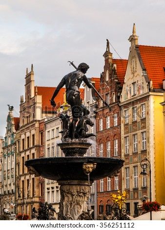 Bronze statue of Neptune, the Roman God of the sea, in Old Town of Gdansk, Poland - stock photo