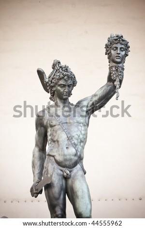 bronze statue of Perseus holding the head of Medusa - stock photo