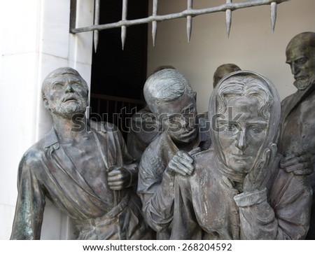 Bronze Statues on the liberty monument in the city of Nicosia in Cyprus.  The monument was erected in 1973 and it symbolizes the Greek Cypriots  struggle for independence   - stock photo