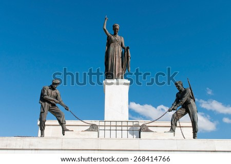 Bronze Statues on the liberty monument in the city of Nicosia in Cyprus.  The monument was erected in 1973 and it symbolizes the Greek Cypriots  struggle for independence.  - stock photo