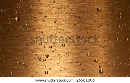 Bronze surface with water drops - stock photo