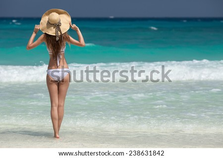 Bronze Tan Woman Sunbathing At Tropical Beach - stock photo