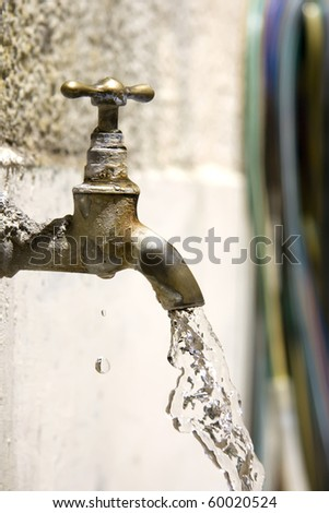 Bronze tap falling and dripping water - stock photo