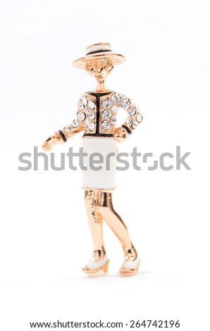 brooch in the form of a woman on a white background - stock photo