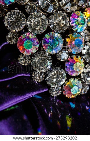 brooch with brilliant stones on violet fabric - stock photo
