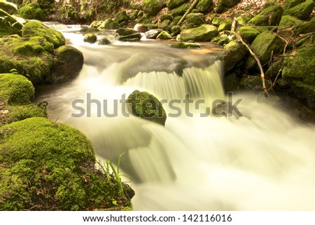 Brook full of mossy rocks at Gertelbach waterfalls, Black Forest, Germany - stock photo