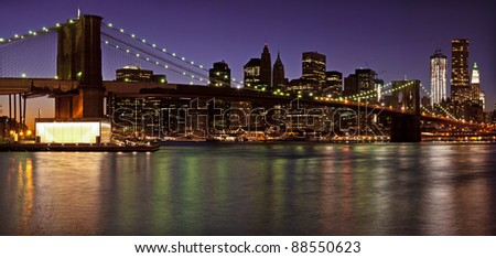 Brooklyn Bridge and Lower Manhattan panorama at dusk. New York City