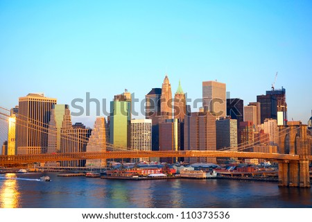Brooklyn Bridge and Lower Manhattan skyline at sunrise in New York City - stock photo