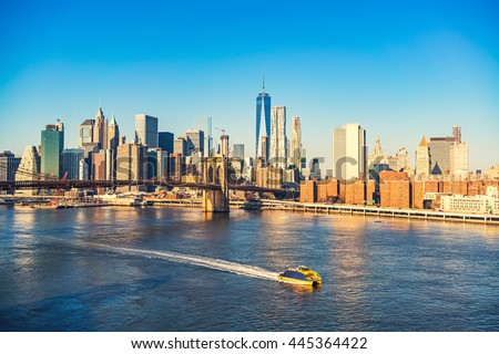 Brooklyn bridge and Manhattan at sunny day, New York City - stock photo