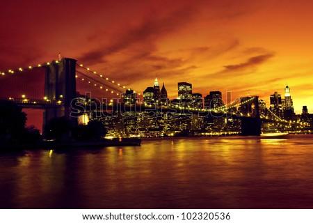 Brooklyn Bridge and Manhattan at sunset, New York - stock photo