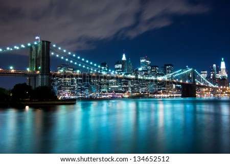 Brooklyn Bridge and Manhattan, New York, night scene - stock photo