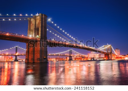 Brooklyn Bridge and Manhattan skyline at night. - stock photo
