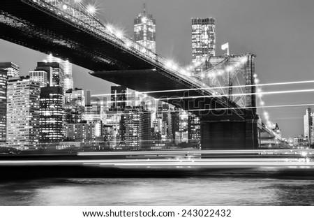 Brooklyn Bridge and Manhattan skyline at night. - stock photo