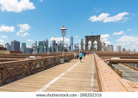 Brooklyn bridge and manhattan skyline in New York - stock photo