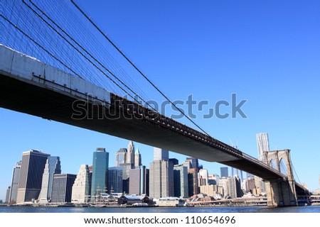 Brooklyn Bridge and Manhattan Skyline on a Clear Blue Day, New York City - stock photo