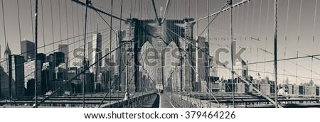 Brooklyn Bridge and Manhattan skyline panorama. - stock photo