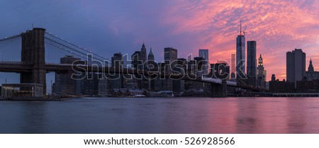 Brooklyn bridge and New York City Manhattan panorama at sunset