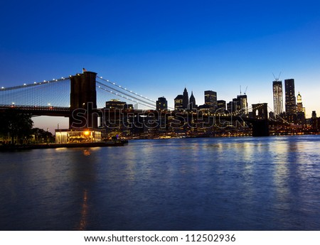 Brooklyn bridge and skyline at night - stock photo