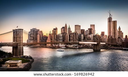 Brooklyn Bridge and the Lower Manhattan at sunset in New York City - stock photo