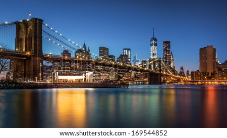 Brooklyn Bridge at dusk viewed from the Brooklyn Bridge Park in New York City. - stock photo