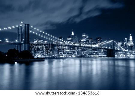 Brooklyn Bridge at night in blue cold tint - stock photo