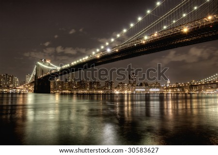 Brooklyn Bridge at night in HDR. - stock photo