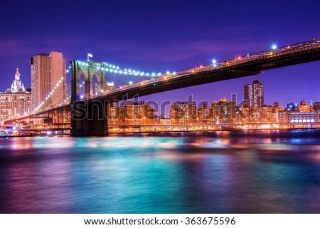 Brooklyn bridge at night in New York - stock photo