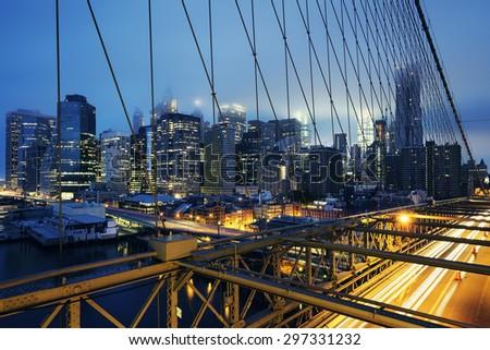 Brooklyn Bridge at night with car traffic - stock photo
