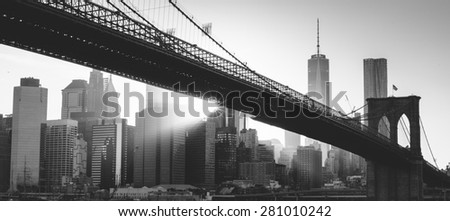 Brooklyn bridge at sunset, New York City in black and white - stock photo