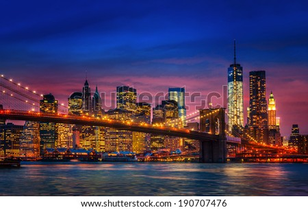 Brooklyn Bridge, East River and Manhattan with lights and reflections. New York - stock photo