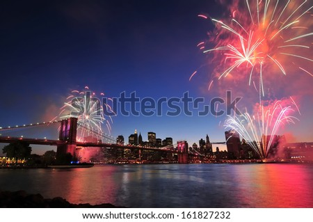Brooklyn bridge in New York at night with fireworks, USA - stock photo