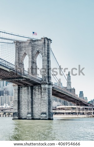 Brooklyn Bridge in New York City United States America  Famous suspension bridge in NYC USA, it connects Manhattan and Brooklyn by spanning the East River. Image with high key filter effect.
