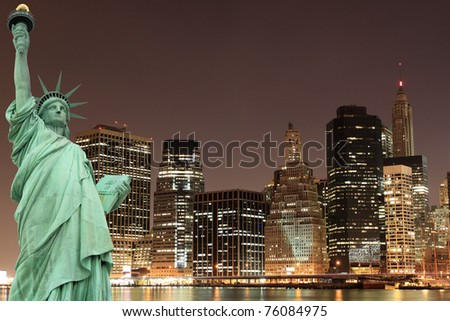 Brooklyn Bridge, Manhattan Skyline and The Statue of Liberty at Night Lights, New York City - stock photo