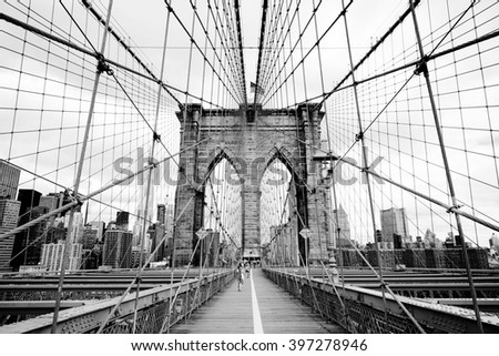 Brooklyn Bridge, New York, USA. Beautiful view of Manhattan, downtown, NYC. Midtown panorama in financial district. Business and travel black and white background. Vintage, retro postcard. - stock photo